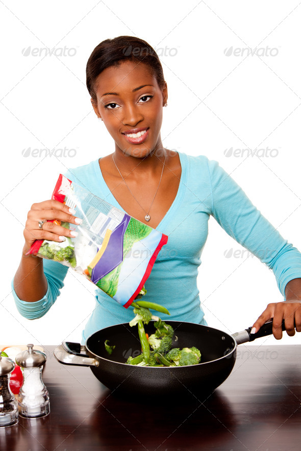 Health conscious woman preparing vegetables - Stock Photo - Images
