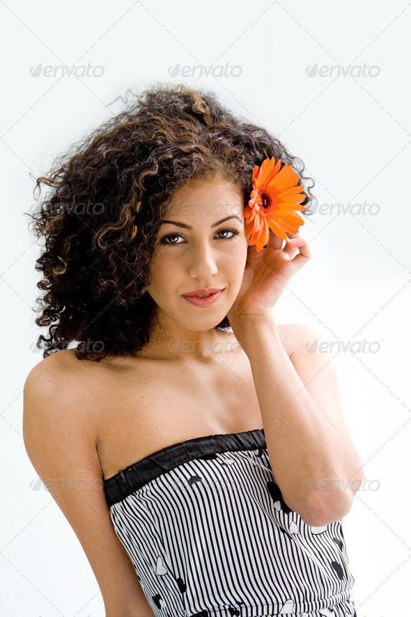 Young girl with flower - Stock Photo - Images