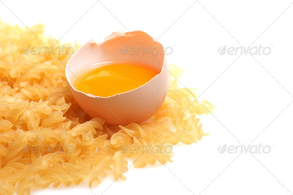 Broken egg and pasta. - Stock Photo - Images