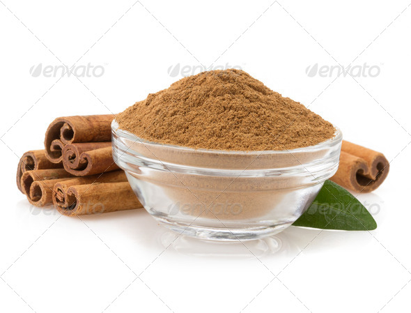cinnamon in bowl on white - Stock Photo - Images