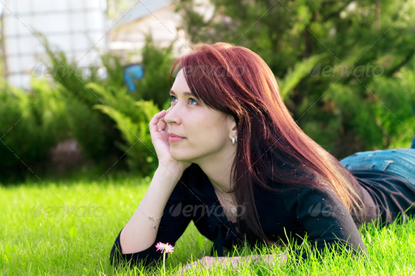 pretty woman lying on green grass - Stock Photo - Images