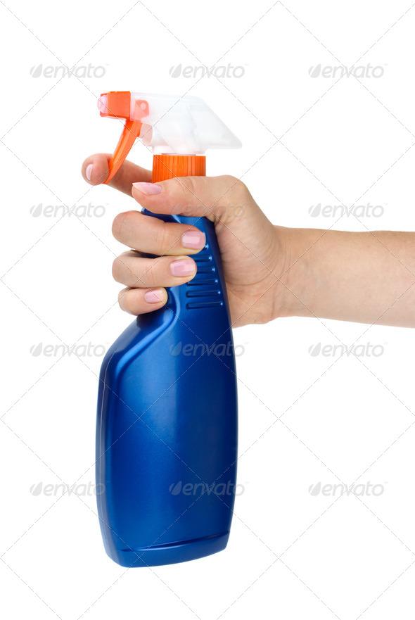 Hand holding blue sprayer bottle - Stock Photo - Images