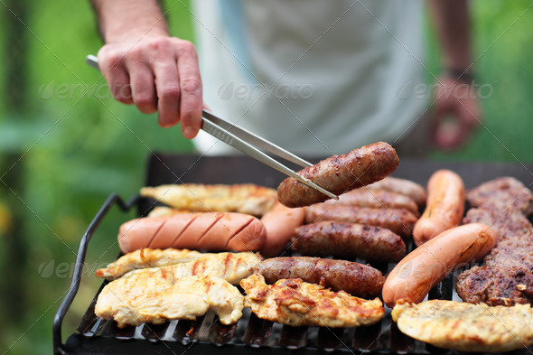 Grilling at summer weekend - Stock Photo - Images