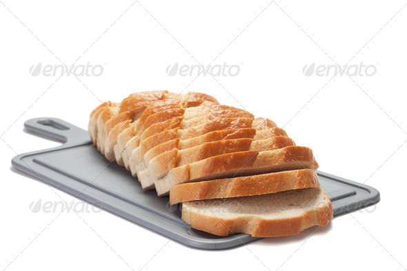 Sliced Bread On Breadboard Isolated - Stock Photo - Images