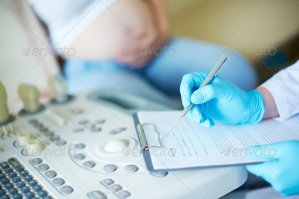 Pregnancy record keeping - Stock Photo - Images