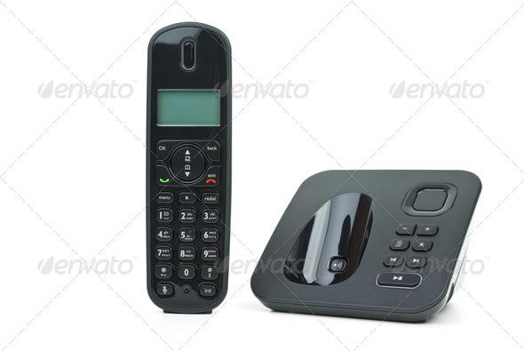Black cordless phone handset and base unit - Stock Photo - Images