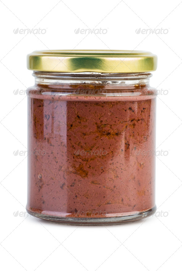 Glass jar with paste maded from red olives (Calamata) - Stock Photo - Images