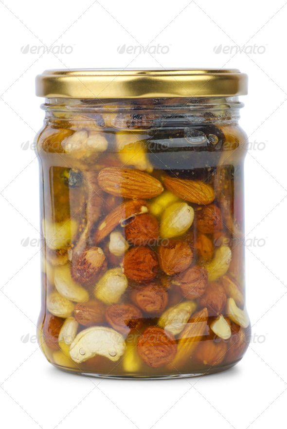 Glass jar with honey, nuts and figs - Stock Photo - Images