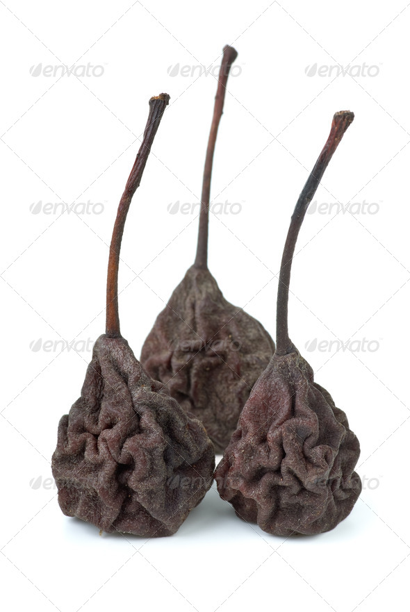 Three dried smoked pears isolated on the white background - Stock Photo - Images