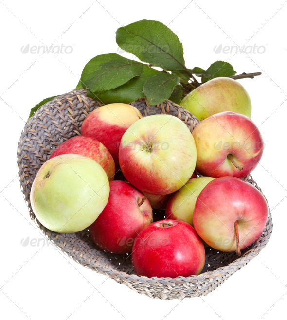 red and yellow apples in straw basket isolated - Stock Photo - Images