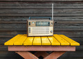 Old radio on yellow table - PhotoDune Item for Sale