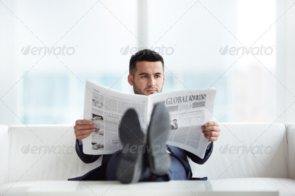 Reading news - Stock Photo - Images
