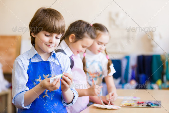 Children drawing and painting - Stock Photo - Images