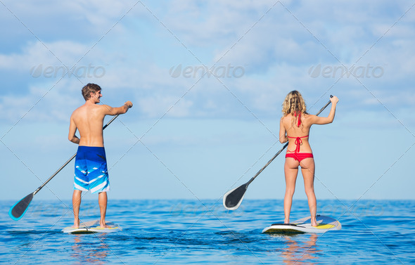 Couple Stand Up Paddling in Hawaii - Stock Photo - Images