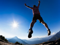 Man jumping in the sunshine against blue sky - PhotoDune Item for Sale