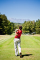 Golf player performs a tee shot using a driver club. - PhotoDune Item for Sale