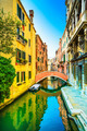 Venice cityscape, sunset in water canal and bridge. Italy