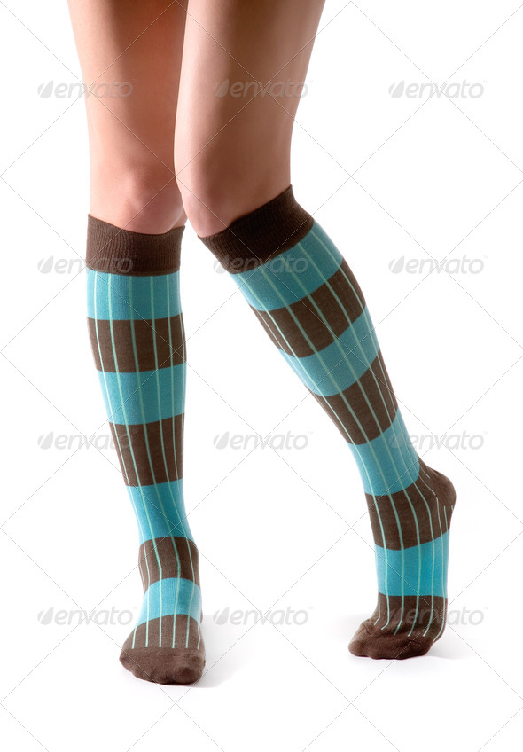 Young woman legs posing with turquoise striped socks - Stock Photo - Images