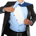 Businessman showing a superhero suit