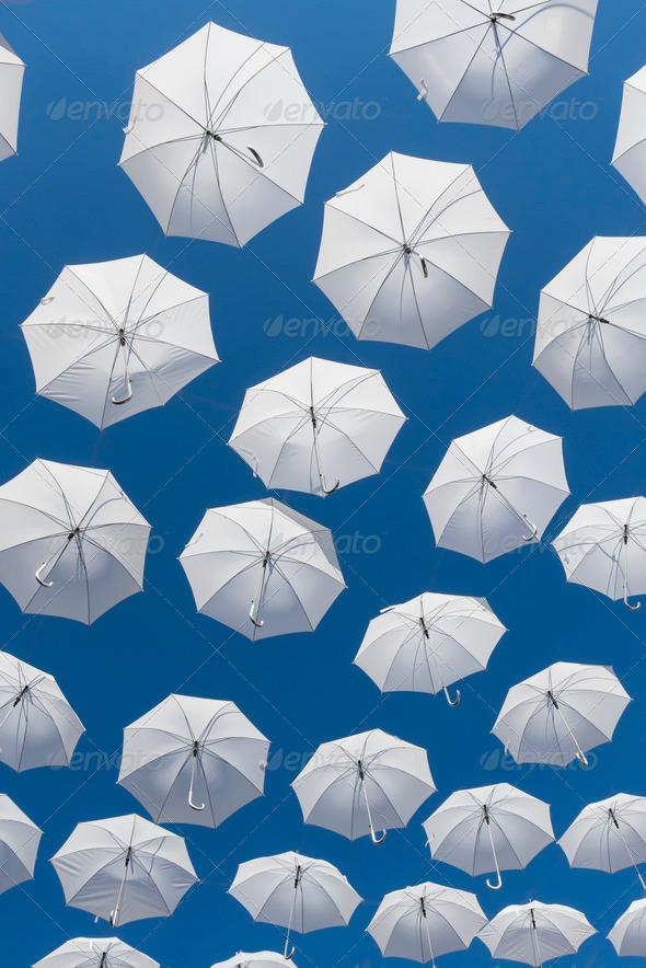 White umbrellas on blue sky - Stock Photo - Images
