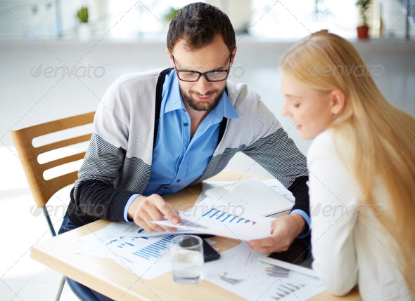 Discussing document - Stock Photo - Images