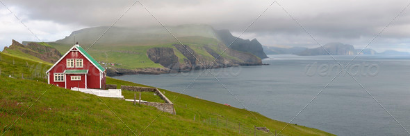 Red farmhouse on coast of Mykines, Faroe Islands - Stock Photo - Images