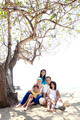 asian family at the beach