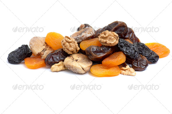 Walnuts and dried fruits collection on white. - Stock Photo - Images