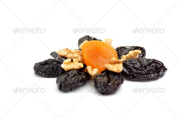 Dried apricot,walnuts and prunes on a white. - Stock Photo - Images
