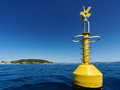 Yellow navigational buoy marker in sea - PhotoDune Item for Sale