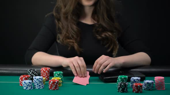 Female Casino Player Checking Cards and Raising, Woman Taking Risk in Poker  Game by Motortion