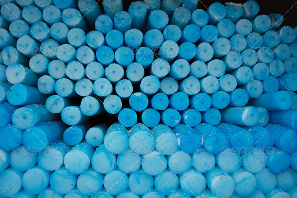 Close up of a group of blue circle candles in Lourdes in France. - Stock Photo - Images