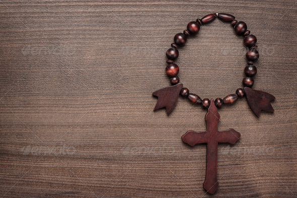 Wooden Cross On Brown Table Background - Stock Photo - Images