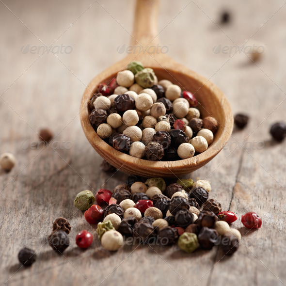 pepper in wooden spoon - Stock Photo - Images