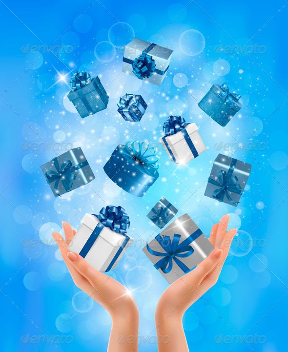 Holiday Background with Hands holding Gift Boxes.  - Christmas Seasons/Holidays