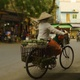 Vietnamese Woman Selling Fruit on a Bike in the Streets of Hanoi, Vietnam - VideoHive Item for Sale