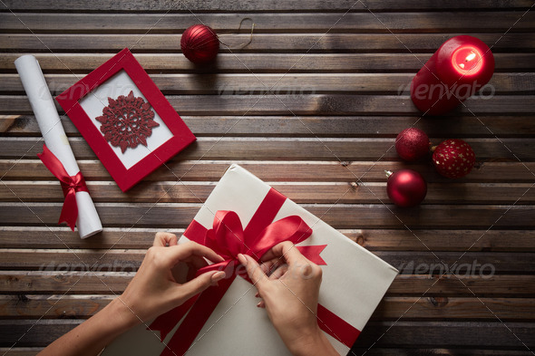 Preparing Christmas gift - Stock Photo - Images