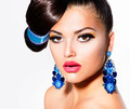 Fashion Model Girl Portrait with Brown Eyes and Blue Earrings - PhotoDune Item for Sale