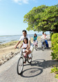 Happy asian family riding bikes in the beautiful morning at the - PhotoDune Item for Sale