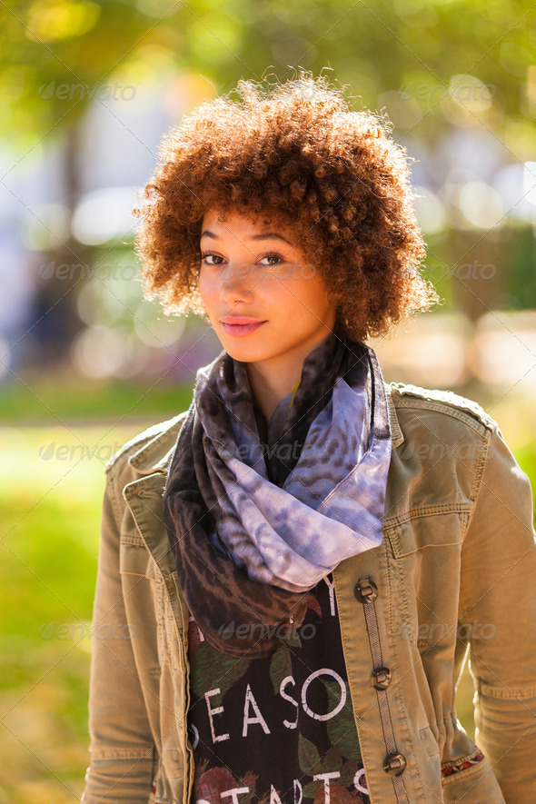 Autumn outdoor portrait of beautiful African American young woma - Stock Photo - Images