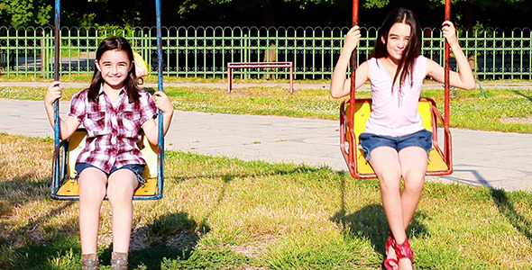 Young girls swinging