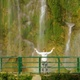 Woman Standing by Waterfall with Her Raised Hands - VideoHive Item for Sale