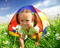 Girl Is Playing Outdoors Under Tent - PhotoDune Item for Sale