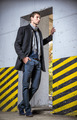 Fashion shot: handsome young man wearing jeans and coat - PhotoDune Item for Sale