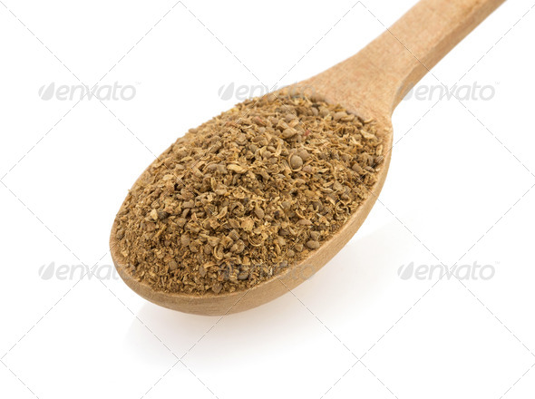 coriander spices and spoon on white - Stock Photo - Images