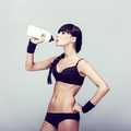 sporty muscular woman drinking water - PhotoDune Item for Sale