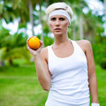 portrait of a young athletic girl with orange - PhotoDune Item for Sale