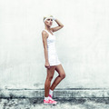 portrait of a young athletic woman at the wall - PhotoDune Item for Sale