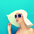 portrait of a girl in a hat on a blue background - PhotoDune Item for Sale