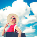 Retro girl on the blue sky background - PhotoDune Item for Sale